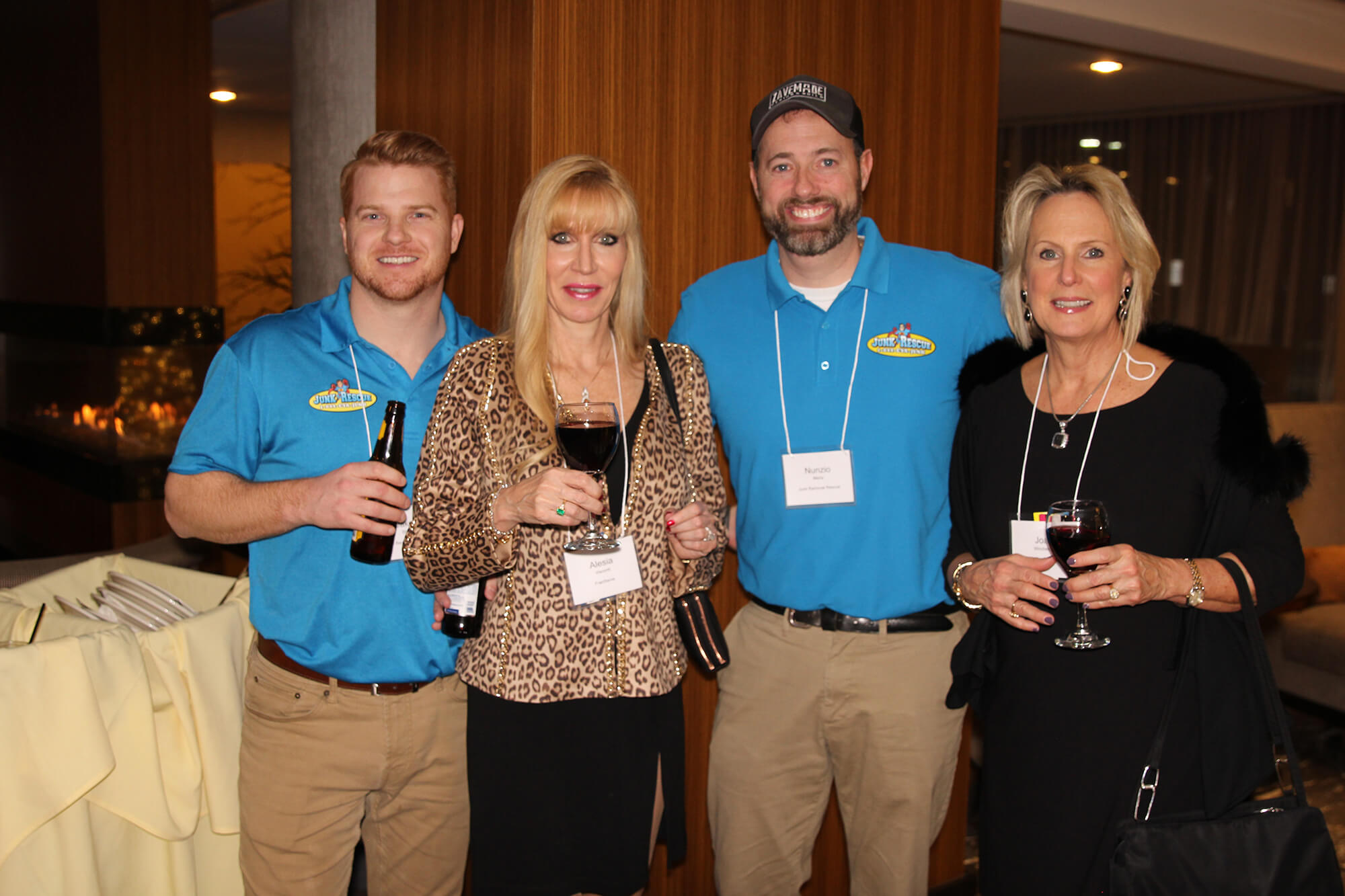 Junk Rescue employees smile for the camera at SMB Franchise Advisors' annual Christmas party.