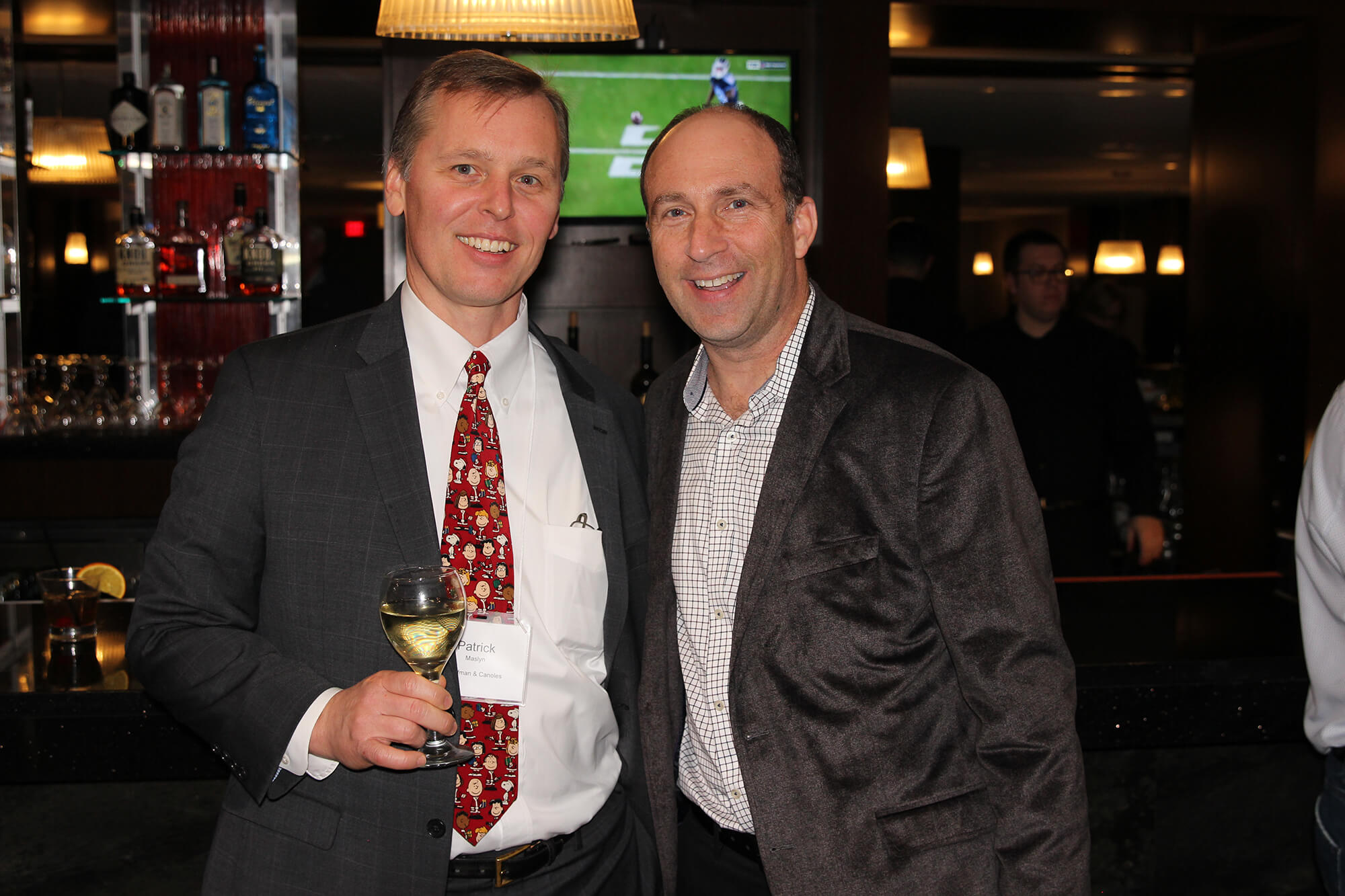 SMB Franchise Advisors President and CEO Steve Beagelman smiles for the camera with party guest and friend Patrick Maslin.