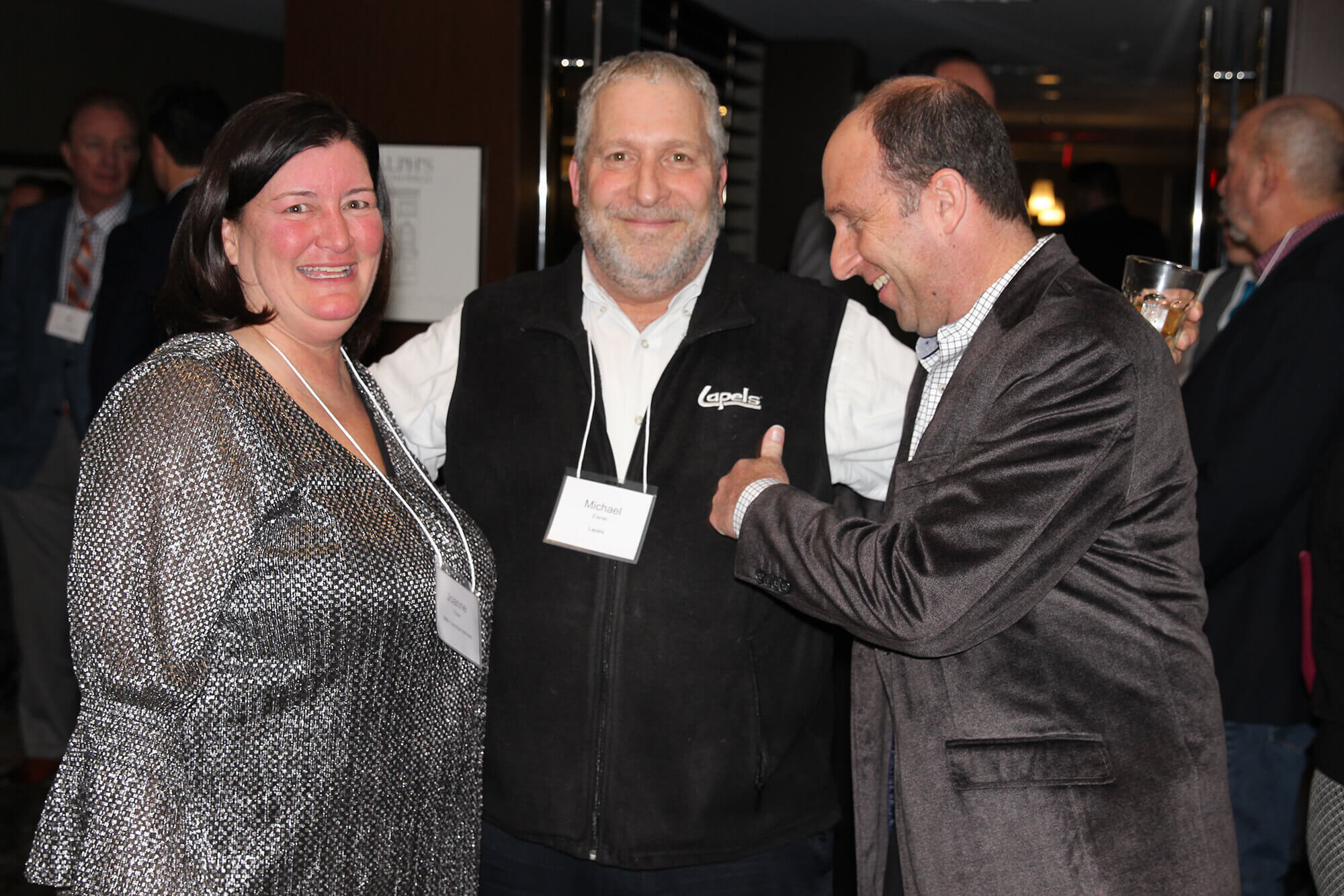 SMB Franchise Advisors Director of Franchise Development Joanne Hoyer and President and CEO Steve Beagelman laughing with a client from Lapels franchise.